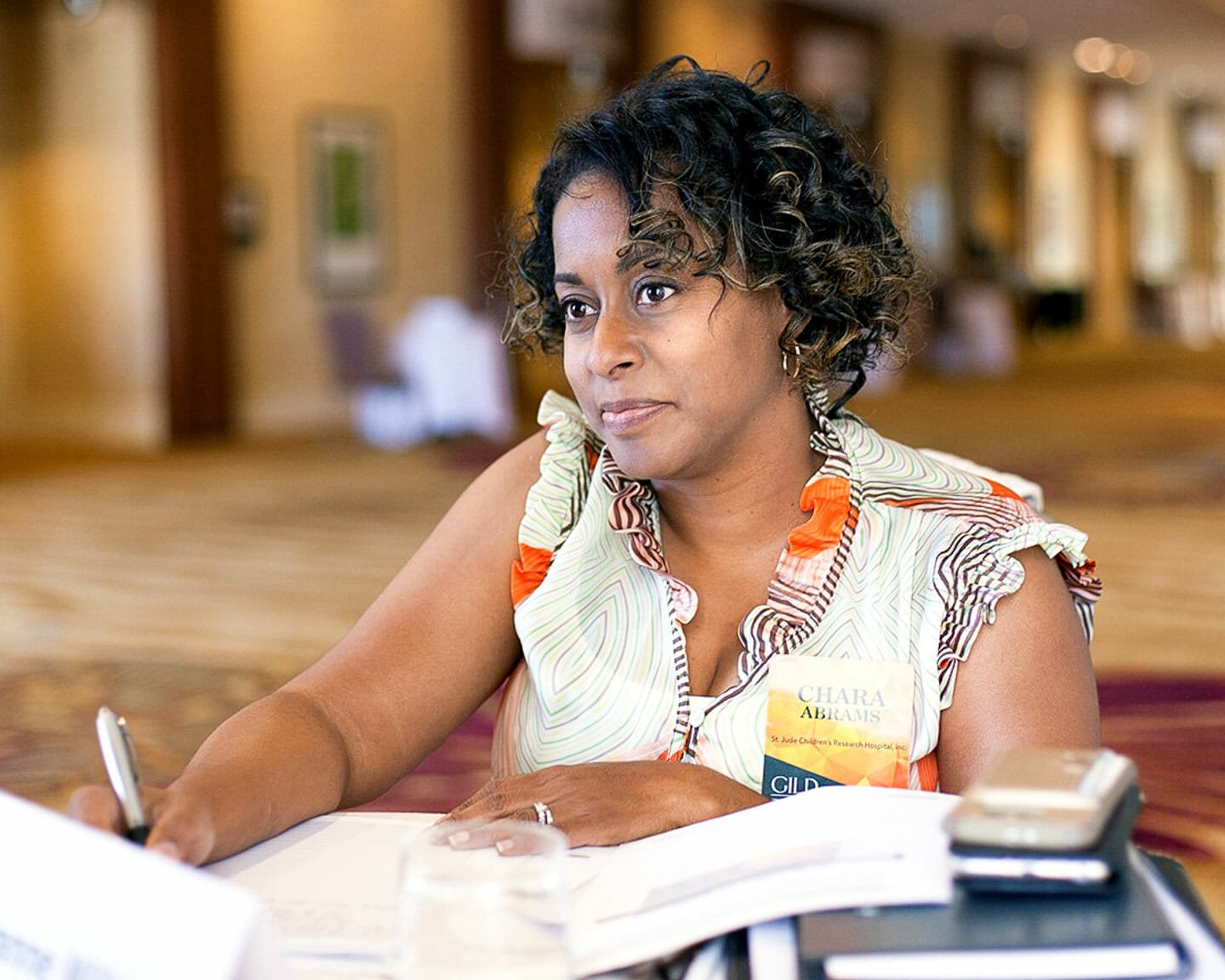 Woman writes on papers at Linkage leadership conference