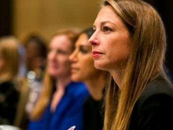 Woman takes notes at Linkage leadership conference