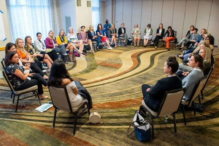 People sit in circle at Linkage conference