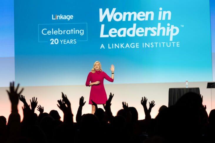 Woman speaks on stage at Women in Leadership Institute